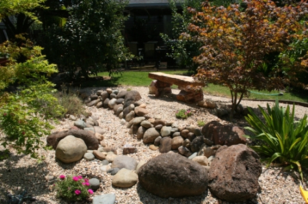 Our stone bench in our back yard